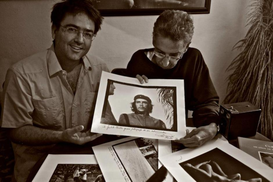 Kike with fine art Cuban photographer Julio Bello, holding a precious gift given to him by Alberto Korda.