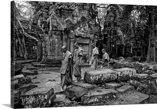 theraveda-buddhist-monks-at-the-ta-prohm-temple-in-the-angkor-complex by KIKE CALVO